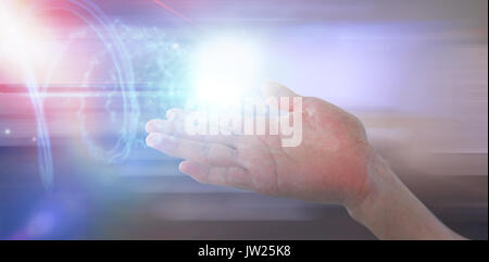 Cropped image of hand pretending to hold invisible object against futuristic shiny spiral on black background - Stock Photo