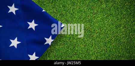 American flag on white background against close-up of grass mat - Stock Photo
