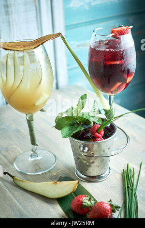 Refreshing sangria or punch with fruits in glass and pincher jpg - Stock Photo