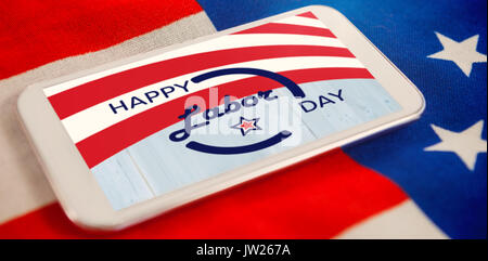 A white flash with a black blackground against mobile phone on national flag - Stock Photo