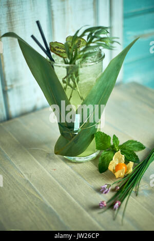 Homemade lemonade from fresh tarthun with lime in glass glasses, selective focus jpg - Stock Photo