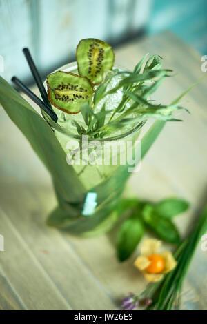 Homemade lemonade from fresh tarthun with lime in glass glasses, selective focus jpg - Stock Photo
