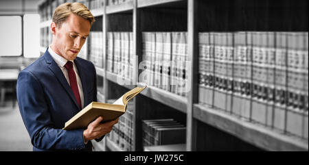 Handsome lawyer reading in law library at university - Stock Photo