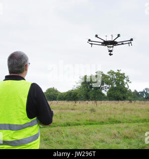 Drone Pilot Preparing and flying a drone / UAV - Stock Photo
