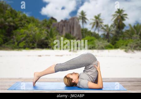 yoga class woman doing plow pose stock photo 11378534