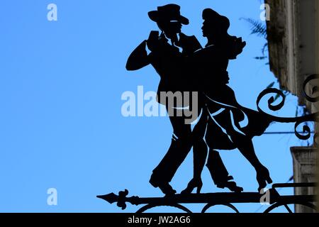 Hanging sign, couple dancing tango, San Telmo, Buenos Aires, Argentina - Stock Photo