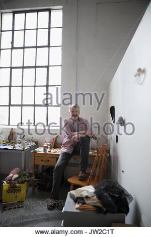 Portrait confident male artist in art studio - Stock Photo