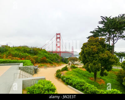 The gold gate bridge in a fog in San Francisco - Stock Photo