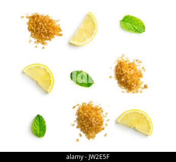 Mojito ingredients. Lemon, mint and cane sugar isolated on white background. Sweet sugar, mint leaves and lemon. - Stock Photo