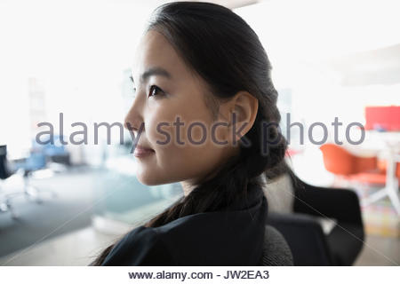 Close up profile serious, pensive businesswoman looking away - Stock Photo