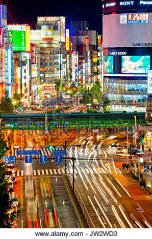 Shinjuku Tokyo Skyline Japan Yasukuni Dori Street Kabukicho at night. - Stock Photo