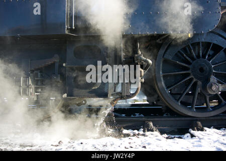 Steam train on winters morning with snow on the ground. - Stock Photo