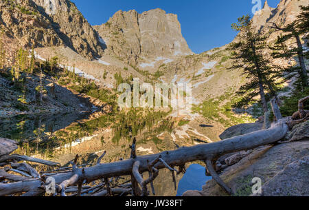 Snow on Hallett Peak and Flattop Mountain reflected in perfectly still Emerald Lake in Rocky Mountain National Park, - Stock Photo