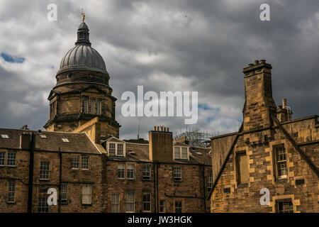 Domed top of Old College, University of Edinburgh with Figure of Youth golden ornamental statue, tenement buildings - Stock Photo