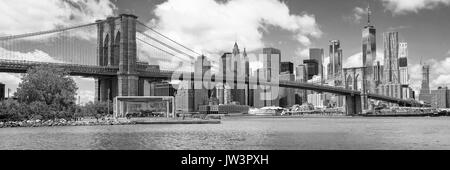 Panorama of Brooklyn Bridge with the Lower Manhattan Skyline - Stock Photo