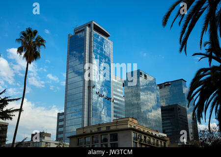 Team of abseilers cleaning windows on modern glass building, Santiago, Chile, South America - Stock Photo