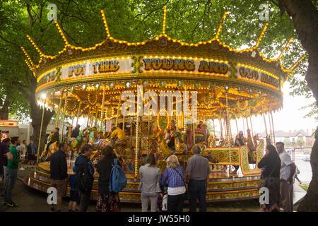 Vintage merry-go-round (carousel) fun-fair / fairground ride attraction at Riverside Festival 2017, Victoria Embankment - Stock Photo