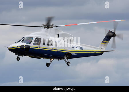 Sikorsky S-76C helicopter G-ROON owned by Rooney Air Ltd of Horsham and operated by Cardinal Helicopter Services - Stock Photo