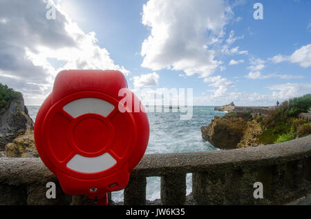 Lifebuoy attached to balustrade in Biarrirz known by its dangerous waves - Stock Photo
