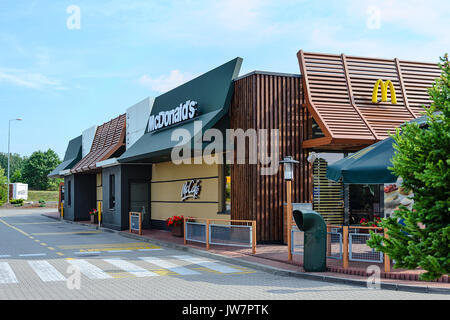 Kozlow, Poland - 20 July, 2017: Exterior view of McDonald's and McCafe Restaurant. McDonald's is the world's largest - Stock Photo
