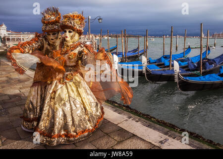 VENICE - FEB 6, 2013: Costumed masked people on the Piazza San Marco during Venice Carnival - Stock Photo
