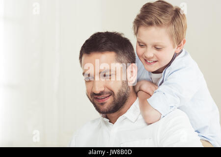 little son with young father spending time at home - Stock Photo