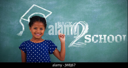 Back to school text on white background against portrait of smiling girl gesturing - Stock Photo
