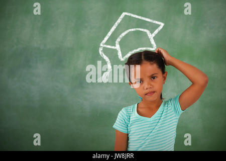 Graduation hat vector against thoughtful young girl - Stock Photo