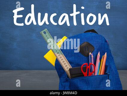Digital composite of Schoolbag on Desk foreground with blackboard education text - Stock Photo
