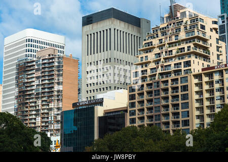 Buildings overlooking Hyde Park in Sydney city centre, New South Wales, Australia. - Stock Photo