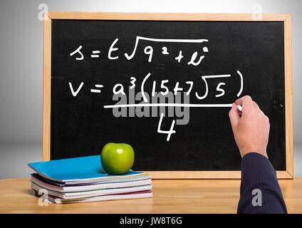 Digital composite of Hand writing math equations on blackboard - Stock Photo