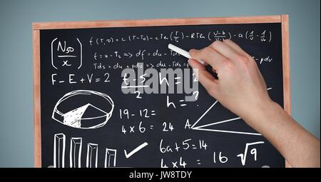 Digital composite of Hand writing equations on blackboard