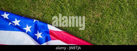 Digital composite of USA flag on grass - Stock Photo