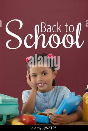 Digital composite of Happy student girl at table against red blackboard with back to school text - Stock Photo
