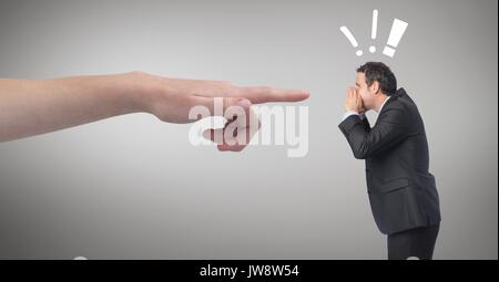 Digital composite of Hand pointing at angry business man against grey background with exclamation icons - Stock Photo