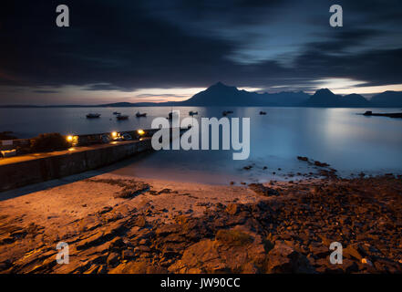Elgol pier and the Cuillin mountains at sunset. Elgol is a small village on the Isle of Skye reached by a narrow - Stock Photo