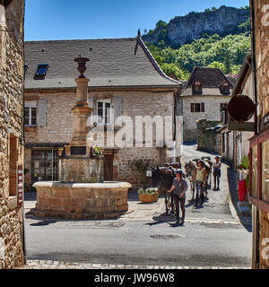 Europe, France, Occitanie, Lot,Place of the fountain in Autoire village, lined with stone half-timbered medieval - Stock Photo