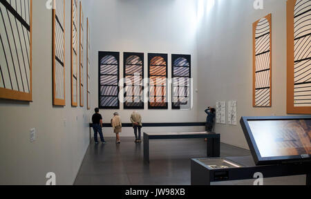 Europe, France, Occitanie,Aveyron,  Rodez city,  Pierre-Soulages museum, The visituer  looks at a painting of the - Stock Photo