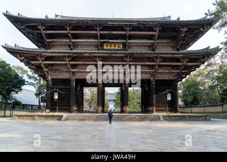 Gate of Todai-ji Temple with tourist walking in Nara, Japan. Nara is a spectacularly picturesque city which is second - Stock Photo