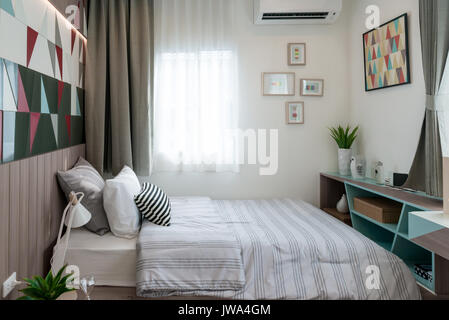 Interior of luxury bedroom in house or hotel with lamp. Interior bedroom concept. - Stock Photo