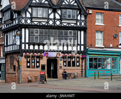 Man sitting outside the Bird in Hand, a Marstons pub in Leek, Staffordshire, England UK - Stock Photo