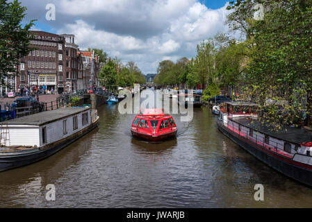 The Prinsengracht with a canal boat, Amsterdam, North Holland, Netherlands - Stock Photo