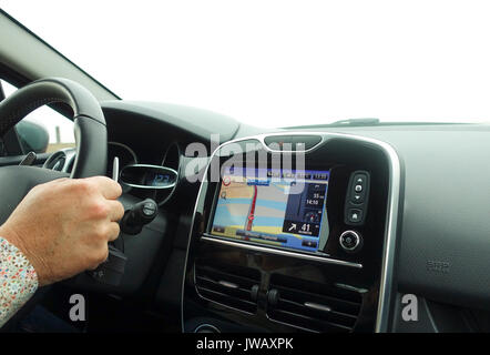 Car navigation system build in interior of modern european car with GPS system on. Netherlands. - Stock Photo