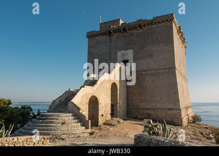 Ancient coastal watchtower in Puglia (Italy). - Stock Photo