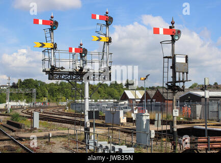 Set of semaphore signals on a gantry and a single signal at one end of Worcester Shrub Hill railway station seen - Stock Photo