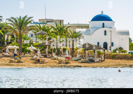 Paphos, Cyprus - September 20, 2016: View of the beautiful beach in Paphos, Cyprus. A fragment of the Mediterranean - Stock Photo