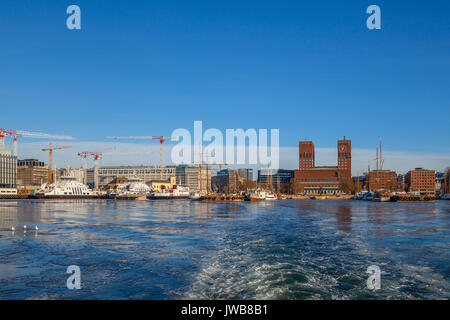 OSLO, NORWAY, 28 FEB 2016: View of City hall, boats and harbour from water - Stock Photo