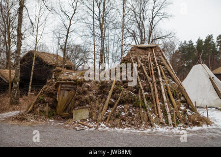Ancient Sami gound and wooden hut - Stock Photo