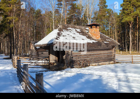 Traditional wooden cottage, baltic and scandinavian style. Winter scene in the countryside. - Stock Photo
