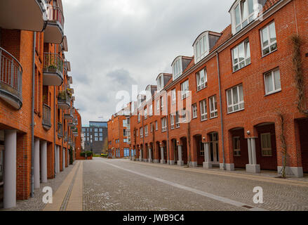 New quarter with red brick business building and pavement - Stock Photo
